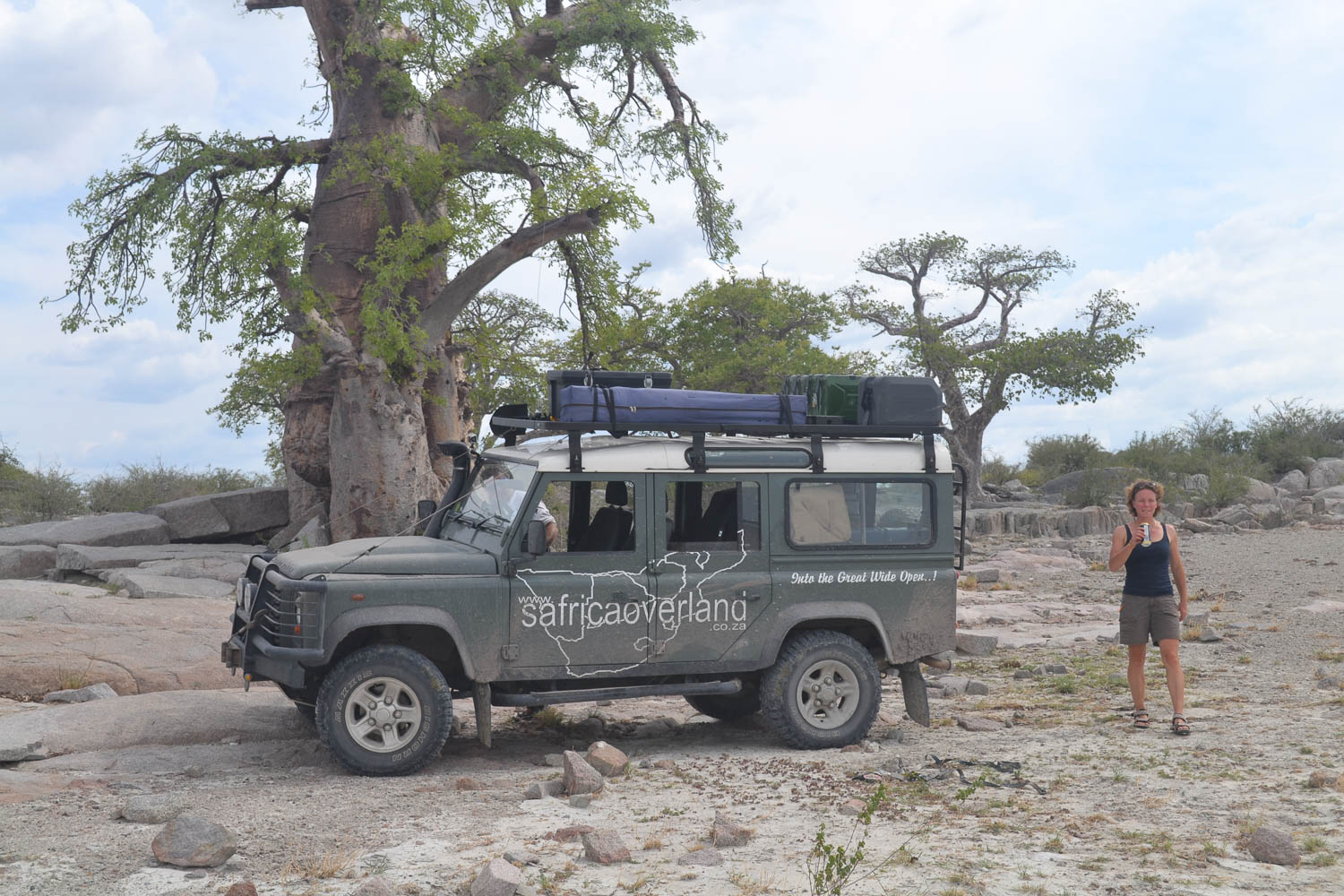 Our Landy dwarfed by a mangificent Baobab Tree with South Africa Overland 4x4 Tours