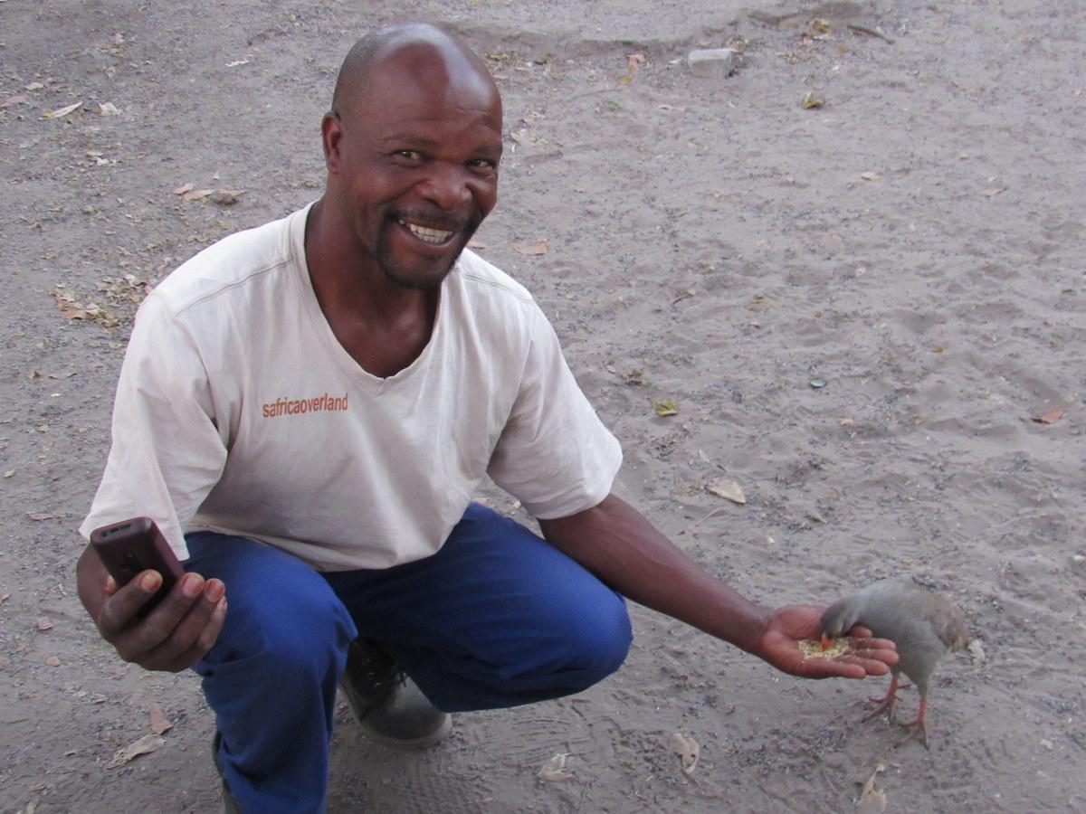 Jeffery feeding a bird, Eco Tourism with South Africa Overland 4x4 Adventure Tours